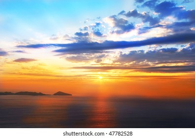 Orange And Blue Sunset On Beach