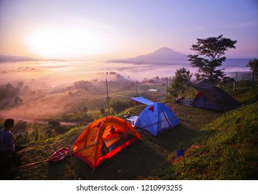 The orange and blue tent is located on the cliff edge. Get sun and morning mist.