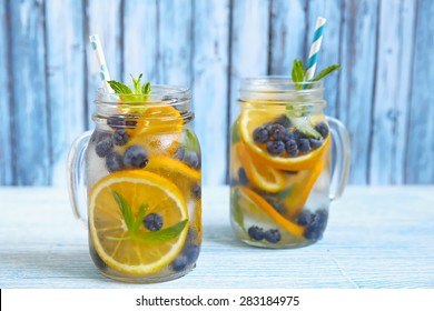 Orange Blueberry Detox Water on wooden table
