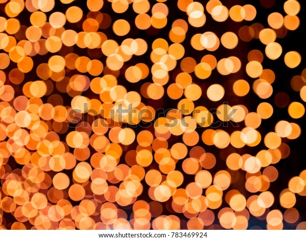 orange blurred bokeh light defocused background and textured,  for Christmas , New Year holidays and celebration background