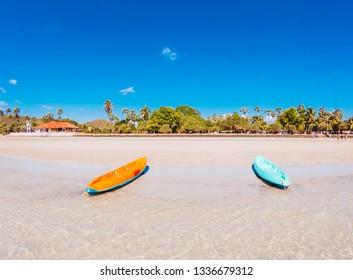Orange boat, blue On the beach in summer.