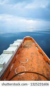 Orange Boat Bow on Calm Glassy Sea, Port Barton, Palawan - Philippines
