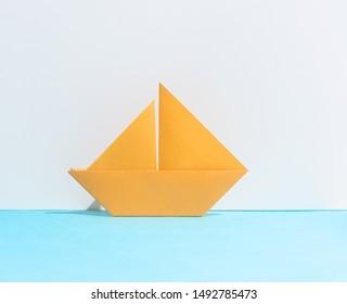 Orange boat on sea background. Minimal summer travel concept.