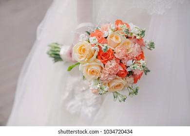 Orange bouquet of the bride