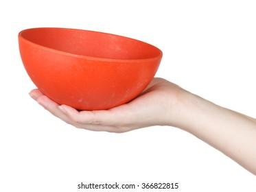 Orange Bowl on a female hand on a white background
