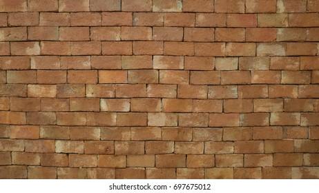 Orange brick wall random pattern background