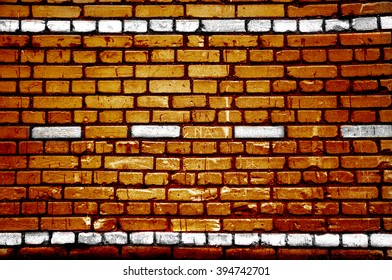Orange brick wall with road lines white