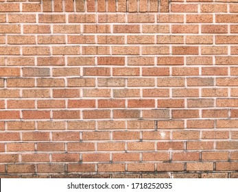 Orange bricks with pink joint cement wall