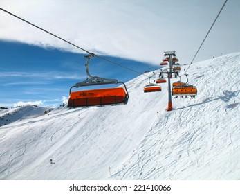 Orange bulbs of chair-lift, Ischgl, Austria.