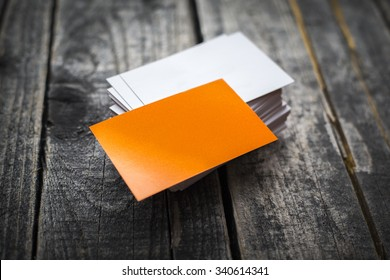 Orange business card identity mockup on wood