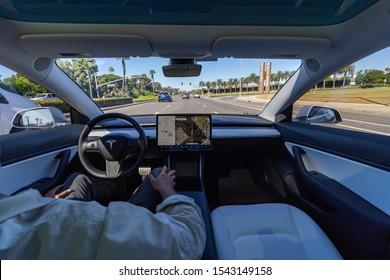 Orange, CA / USA - 10/27/2019: Autonomous Tesla Model 3 car in full self driving or autopilot mode showing future of electric cars.