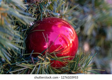 Orange, CA / USA - December 29 2018: Large Christmas tree ornaments on the tree at the center of Orange