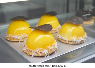 Orange cake with chocolate in bakery shop glass display. for happy birthday and Valentine's Day celebration or other celebration.