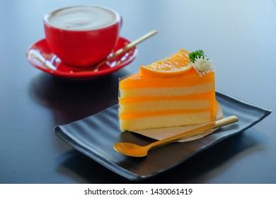 Orange cake and coffee background