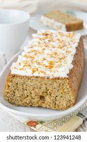 orange cake with cream cheese frosting, closeup