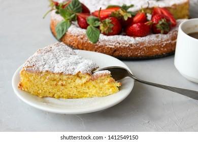 Orange cake decorated with strawberries