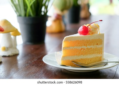Orange Cake On Wooden Table