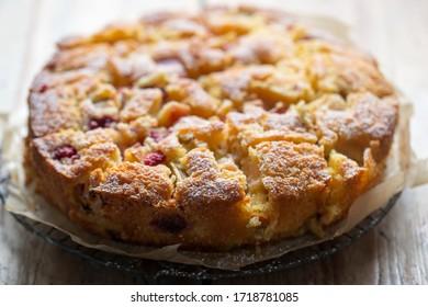 Orange cake with raspberries and rhubarb