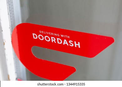 Orange, California/United States - 03/19/19: A red sticker decal on a restaurant door advertising delivery service available through DoorDash