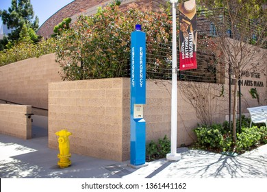 Orange, California/United States - 04/03/19: A blue emergency telephone system post on a college campus