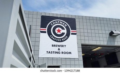 Orange, California/United States - 04/15/2019: A store front sign for Chapman Crafted Beer