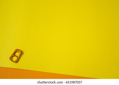 Orange can tab on yellow background