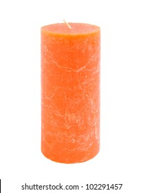 An orange candle isolated on a white background.