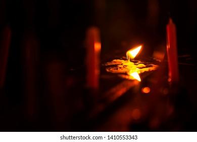Orange candle light at night.