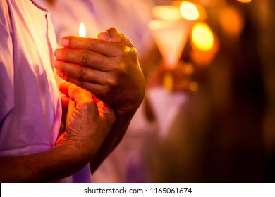 The orange candle lit up to indicate love and respect. Both expressions of faith. The hand that protects the wind from blowing the candle is off.