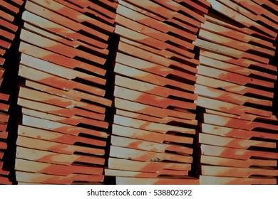 Orange and caramel brick wall under the sunlight
