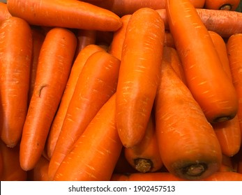 Orange carrots, tubers in the soil, bring to food, good taste, pleasant to eat.