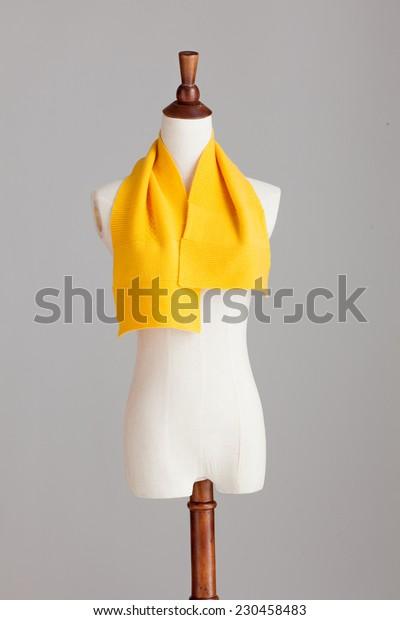 orange cashmere neckerchief with wood model on grey isolated