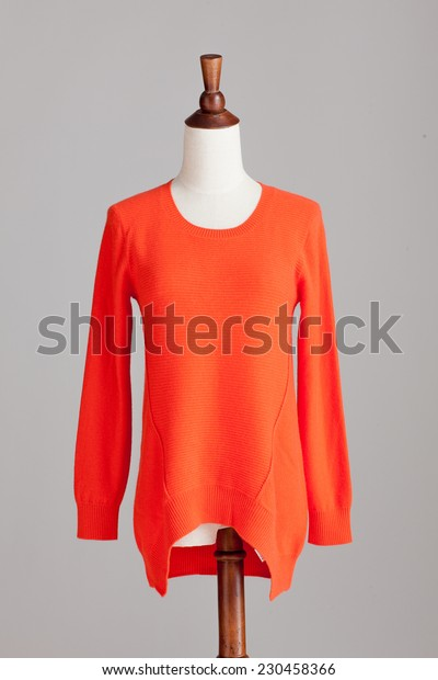 orange cashmere sweater with wood model on grey isolated