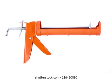 Orange caulking gun isolated on white background.
