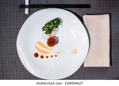 orange caviar tartare with decorative sauces and vegetable julienne, asian fusion cousine