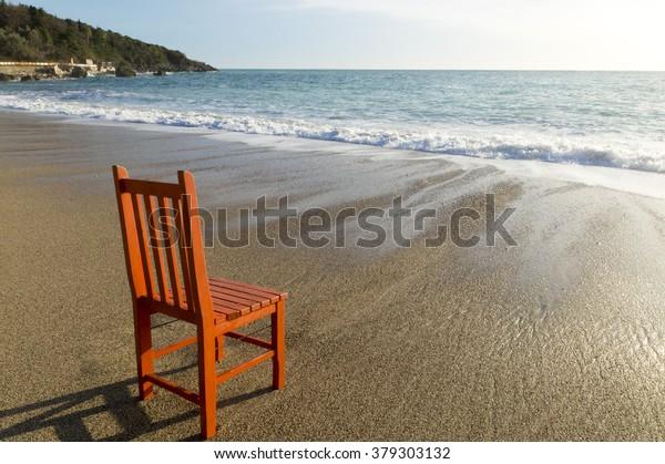 orange chair on the beach