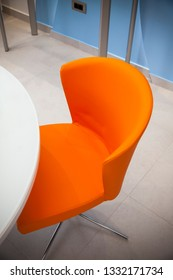 orange chair and white table, close up