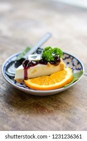 Orange  cheese cake topped up  Blueberry Jam on thai benjarong bowl