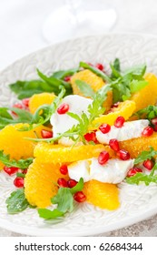 Orange and cheese salad with pomegranate seeds