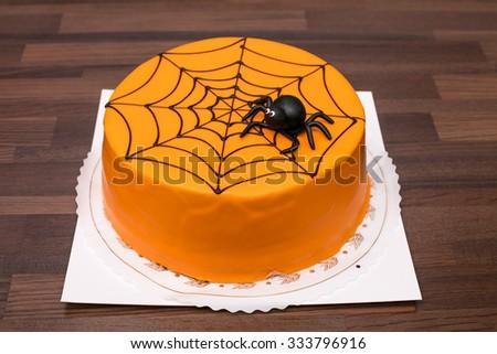 Orange Childrens Birthday Cake With Black Spider Decoration In Finland Focal Point Is The