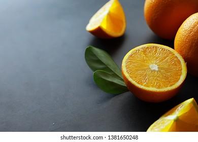 Orange citrus fruit on stone table. Orange background.