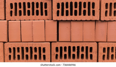 orange clay brick stack, pile. texture, background.