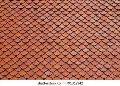 Orange clay tile roof texture of Thai temple