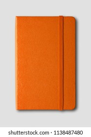 Orange closed notebook mockup isolated on grey