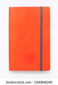Orange closed notebook mockup isolated on white