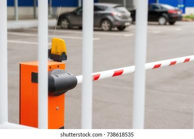 Orange closed parking barrier for cars