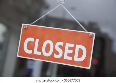Orange Closed Sign on Shop Door
