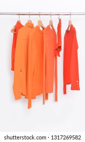Orange clothes with knitted .sweater , jacket on hanger