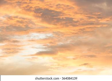orange clouds at sunset background (soft focus)
