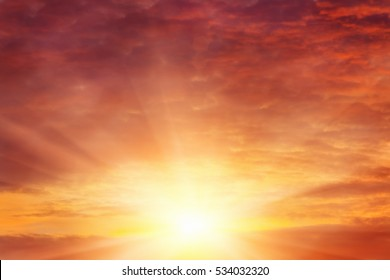 Orange cloudy sky with evening sun. Red sunset or sunrise background